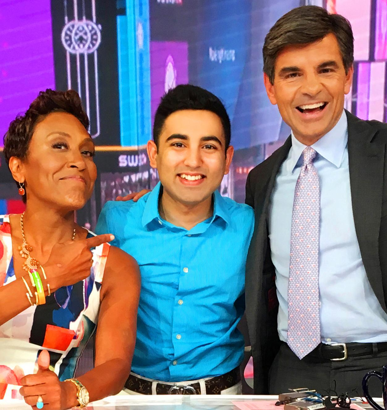 Student Shobhit Jain posing with Good Morning America co-hosts