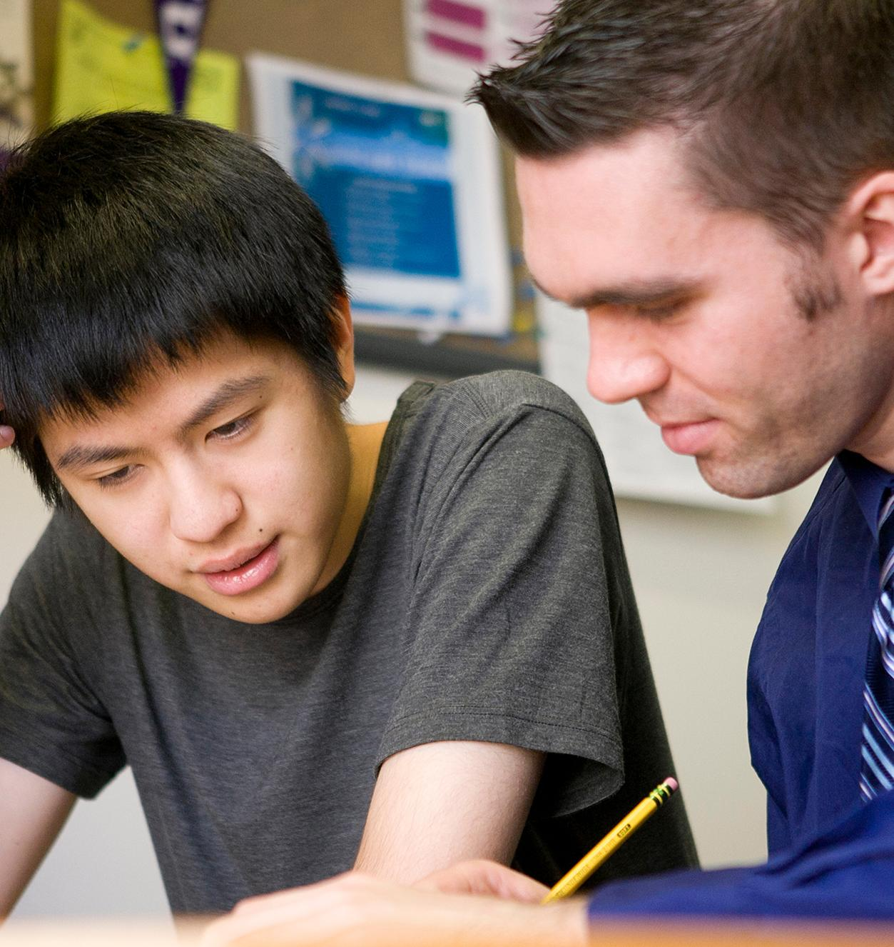 A student meets with an adviser one-on-one