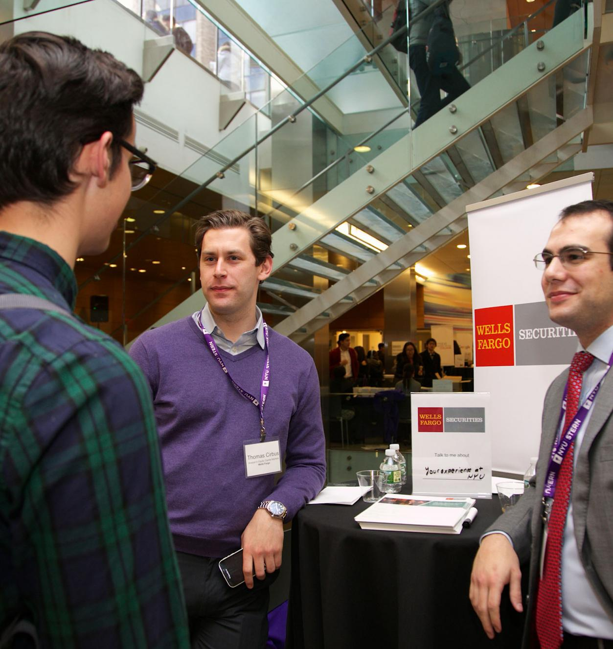 Representatives from Wells Fargo chat with students on campus