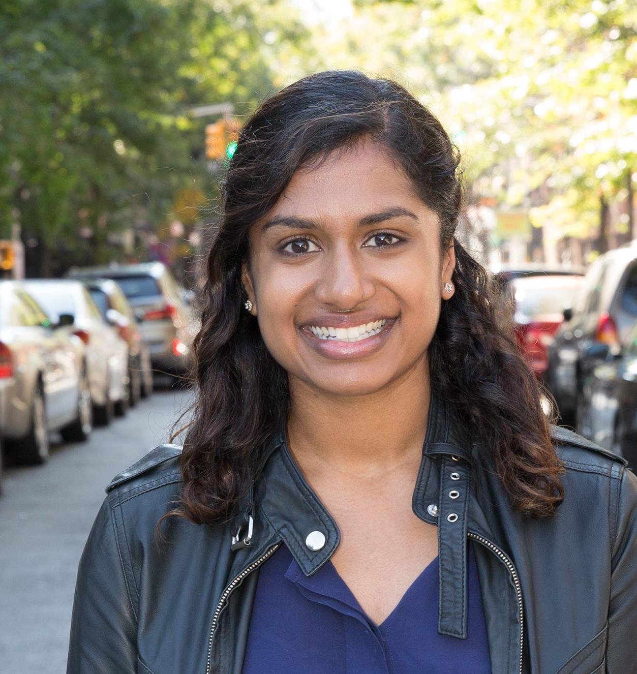 Aditi Shankar in NYC street with cars parked on both sides