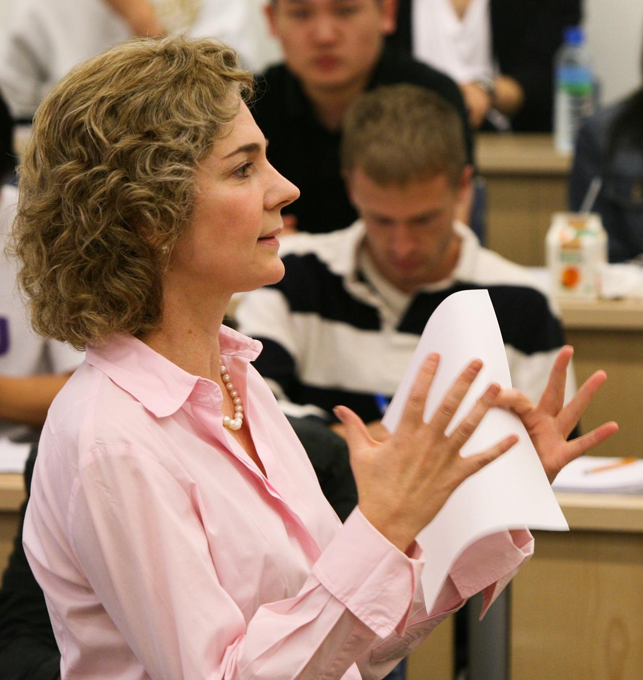 Finance Professor Jennifer Carpenter teaches in class