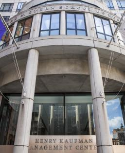 Front of KMC with NYU Flags