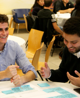 Two students discuss sticky notes during an interactive exercise