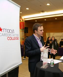 Students chat with with a recruiter from Macy's at an on-campus event