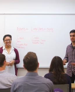 Students give a presentation in a classroom
