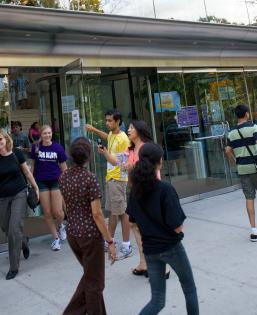 Students gather in front of the NYU Kimmel Center for University Life