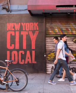 """New York City Local"" spray painted on wall in NYC Streets"