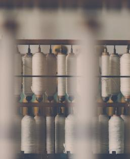 Spools of cotton reels in a manufacturing plant
