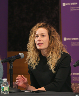 a woman speaking at a panel